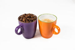 Two coffee mugs 03. Two coffee mugs one with coffee one with beans Royalty Free Stock Photos