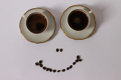 Two Coffee smiling. Two cups of coffee and a smile Stock Photography