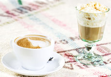 Two coffees. On table with orginal tablecloth Royalty Free Stock Images