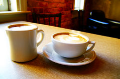 Two coffees. Two cups of cappuccino coffee on a table Stock Images