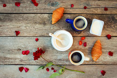 Two coffees, croissants, sugar, candy, yoghurt, rose and petals Stock Photography