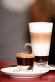 Two coffees - epresso with cream and cafe latte Royalty Free Stock Image