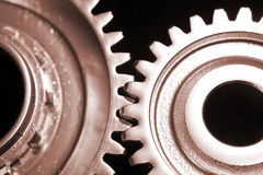 Two cogs. On black background Stock Photography