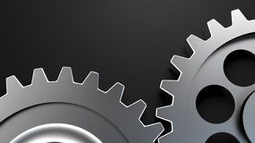 Two cogwheels together on dark surface Royalty Free Stock Photos