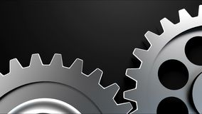 Two cogwheels together on dark surface stock video footage