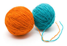 Two coil with woolen threads of different colors. Isolated on a white background Stock Photo