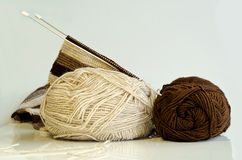 Two coil of yarn and knitting needles Stock Photos