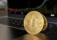 Gold Bitcoin cryptocurrency on laptop keyboard stock photos