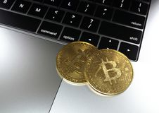 Gold Bitcoin cryptocurrency on laptop keyboard stock images