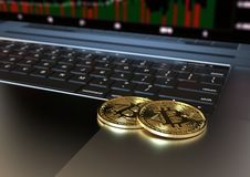 Two Gold Bitcoin virtual money on laptop keyboard royalty free stock photography