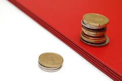 Two coins towers. Isolated. Business metaphor Stock Photography