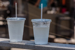 Two cold carbonated drinks. In transparent plastic cups Royalty Free Stock Photography