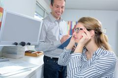 Two coleagues in modern office. Female stock photography