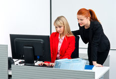 Two colleague worker in office with computer Stock Photography