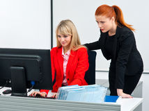Two colleague worker in office with computer Royalty Free Stock Photos