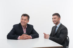 Two colleagues business partners sitting at desk Royalty Free Stock Photography