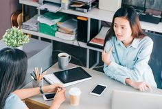 Two colleagues causal meeting at home office desk about business Royalty Free Stock Photo