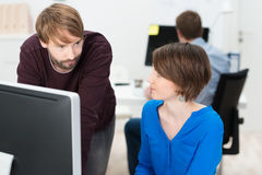 Two colleagues chatting in the office Royalty Free Stock Images