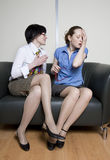 Two colleagues discuss gossip Stock Images