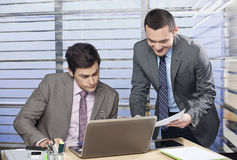 Two colleagues discussing stock images