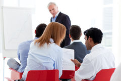 Two colleagues discussing together at a seminar Stock Image