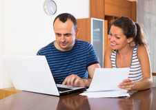 Two colleagues with documents at office Royalty Free Stock Photo
