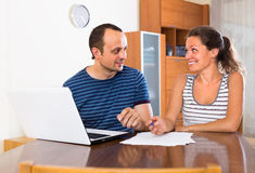 Two colleagues with documents at office Royalty Free Stock Photos