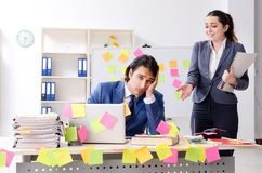 The two colleagues employees working in the office stock photography