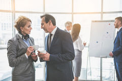 Two colleagues are having a chat Royalty Free Stock Image