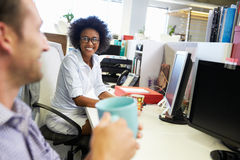 Two colleagues having a coffee break at work Stock Image