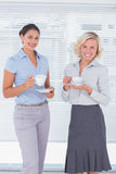 Two colleagues holding cup of coffee Royalty Free Stock Photography