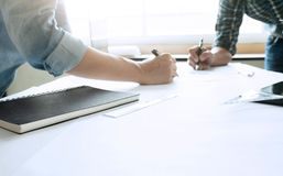 Two colleagues interior designer Cooperation Corporate Achievement Planning Design Draw Teamwork Concept on architectural project royalty free stock photography