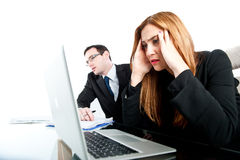 Two colleagues looking stressed whilst at work Stock Photos