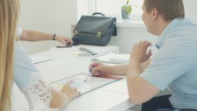 Two colleagues men and women have a discussion in the office.  stock video footage