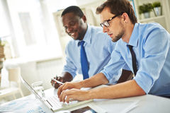 Two colleagues in office Royalty Free Stock Image