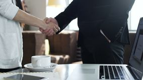 Two colleagues shake hand after negotiations. Closeup. Male and female success person signed a agreement between companies and congratulation deals slow motion stock video