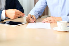 Two colleagues is signing a contract, business meeting in the office Royalty Free Stock Image
