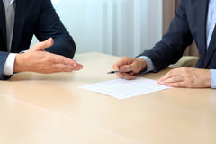 Two colleagues is signing a contract, business meeting in the office Stock Images