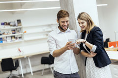 Two colleagues spending some time together in an office Stock Photo