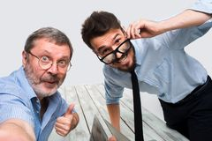 Two colleagues  taking the picture to them self sitting in  office Royalty Free Stock Photo