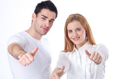 Two colleagues with thumbs-up Royalty Free Stock Images
