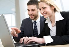 Two colleagues using lap-top Royalty Free Stock Photos