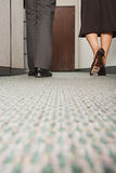 Two colleagues walking along corridor Royalty Free Stock Image
