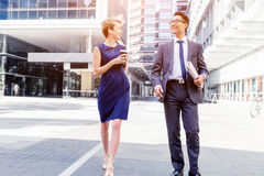 Two colleagues walking together in a city Royalty Free Stock Photo
