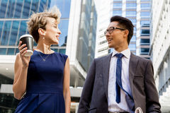 Two colleagues walking together in a city Royalty Free Stock Photography