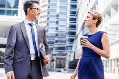 Two colleagues walking together in a city Stock Photography
