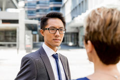 Two colleagues walking together in a city Royalty Free Stock Photos