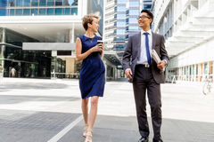 Two colleagues walking together in a city Royalty Free Stock Image