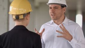 Two colleagues in the work plan discussing at a construction site. Close up. Professional shot in 4K resolution. 104. You can use it e.g. in your commercial stock photos