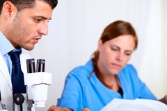 Two colleagues working at laboratory Royalty Free Stock Images
